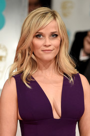 Reese Witherspoon looked oh-so-pretty with her piecey waves and side-swept bangs at the EE British Academy Film Awards.