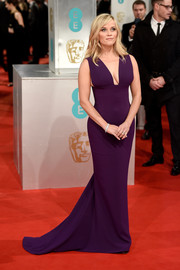 Reese Witherspoon cut a perfectly curvy silhouette in a low-cut purple Stella McCartney gown during the EE British Academy Film Awards.