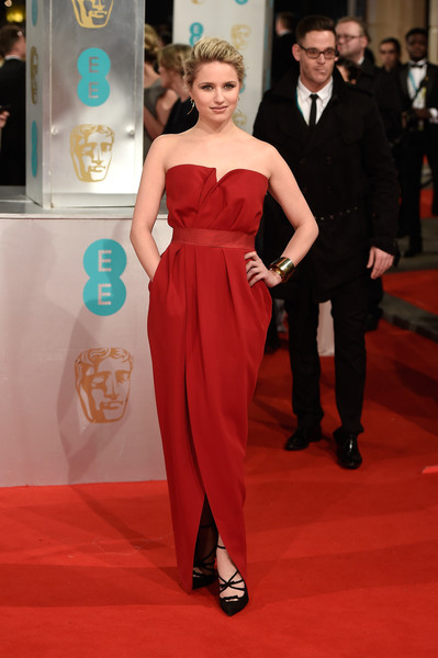 Dianna Agron looked fab in red at the 2015 British Academy Film Awards wearing a cinched in gown that crossed at the skirt.