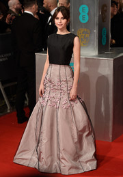 Felicity Jones looked breathtakingly sweet in her flower-appliqued pink Christian Dior Couture skirt during the EE British Academy Film Awards.