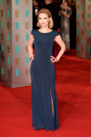 Myanna Buring looked simply stunning at the 2015 British Academy Film Awards in a full-length dress with knee-high split.
