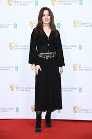 Kaitlyn Dever went for edgy styling with a pair of two-tone ankle boots, also by Chanel.