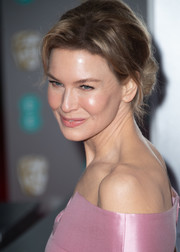 Renee Zellweger looked romantic and elegant wearing this loose bun at the 2020 EE British Academy Film Awards.