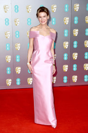 Renee Zellweger was all about sweet glamour in a pink off-the-shoulder column dress by Prada at the 2020 EE British Academy Film Awards.