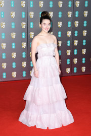 Kaitlyn Dever went the ultra-feminine route in a strapless, tiered pink gown by Miu Miu at the 2020 EE British Academy Film Awards.