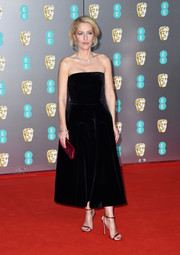 An Anya Hindmarch velvet clutch completed Gillian Anderson's red accessories.