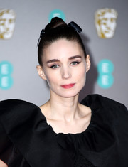 Rooney Mara styled her hair into a sculpted top knot for the 2020 EE British Academy Film Awards.
