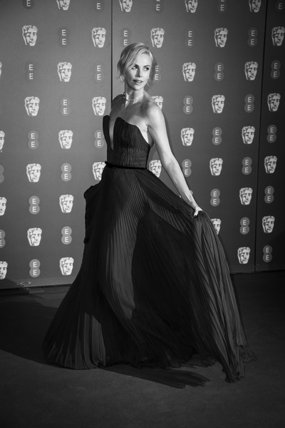 More Pics of Charlize Theron Strapless Dress (3 of 25) - Dresses & Skirts Lookbook - StyleBistro [image,black,dress,gown,clothing,lady,beauty,black-and-white,fashion,fashion model,model,charlize theron,british academy film awards,ee,england,london,royal albert hall,red carpet arrivals,charlize theron,royal albert hall,73rd british academy film awards,photograph,photography,model,fashion,lookbook,black and white,dress]