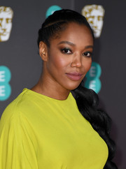 Naomi Ackie wore her hair in a long braid at the 2020 EE British Academy Film Awards.