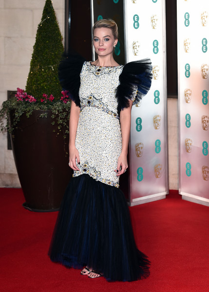 Margot Robbie looked like royalty in an embellished silver and navy mermaid gown by Chanel Couture at the EE British Academy Film Awards.