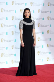 Gugu Mbatha-Raw looked downright regal in a vintage black Cardinali gown with a crystal-accented yoke and sleeves at the EE British Academy Film Awards.