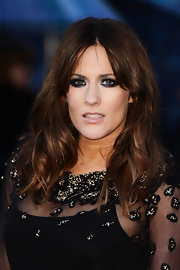 A dark smoky eye added some edge to Caroline Flack's glamorous red carpet look at the 2013 BAFTAs.