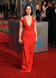 Emilia Clarke put on a sultry display in a curve-hugging, deep-V cutout gown by Victoria Beckham at the BAFTAs.