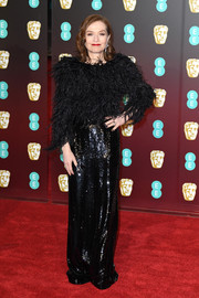 Isabelle Huppert added some sparkle with a long black sequin skirt, also by Armani Privé.