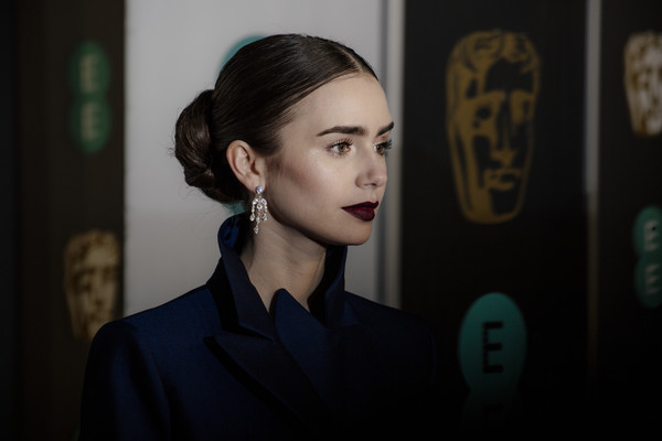 More Pics of Lily Collins Dark Lipstick (2 of 21) - Makeup Lookbook - StyleBistro [face,hair,head,eyebrow,hairstyle,lip,eye,photography,black hair,flash photography,red carpet arrivals,lily collins,ee,london,england,royal albert hall,british academy film awards]