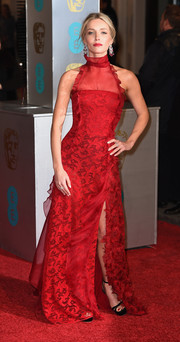 Annabelle Wallis kept it classic and feminine in a red lace halter gown by Oscar de la Renta at the BAFTAs.
