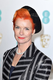 Sandy Powell sported a short, side-parted 'do, which she adorned with a lopsided pillbox hat, at the 2019 EE British Academy Film Awards.
