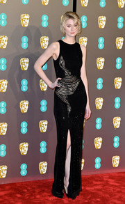 Elizabeth Debicki brought subtle sparkle to the red carpet with this micro-beaded column dress by Armani Prive at the EE British Academy Film Awards.