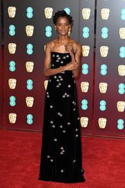 Letitia Wright got all dolled up in a black Gucci velvet gown with crystal bee accents for the EE British Academy Film Awards.