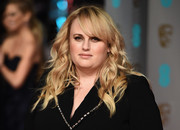 Rebel Wilson wore loose curls with side-swept bangs during the BAFTAs.