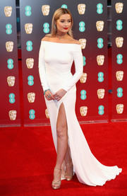 Laura Whitmore looked downright elegant in a high-slit white off-the-shoulder gown by Suzanne Neville at the 2017 BAFTAs.