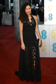 The ceaselessly beautiful Thandie Newton showed up at the BAFTAs in a beautifully fitted black lace halter gown with a sheer skirt. She parted her curls to the side to reveal fabulous gold earrings and a dark fuchsia lipstick.