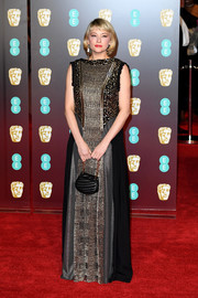 Haley Bennett got sparkled up in a black and gold Chloe gown with sequin detailing for the EE British Academy Film Awards.