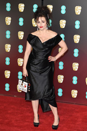 Helena Bonham Carter attended the EE British Academy Film Awards wearing a Vivienne Westwood LBD that featured the brand's signature draped, off-the-shoulder silhouette.