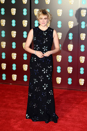 Greta Gerwig kept it ladylike in a floral-embroidered black gown by Jonathan Cohen at the EE British Academy Film Awards.