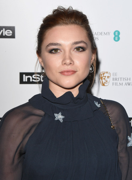Florence Pugh attended the EE InStyle party wearing her hair in a messy updo.