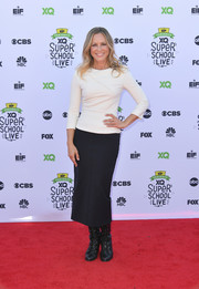 Maria Bello paired her top with a black midi pencil skirt.