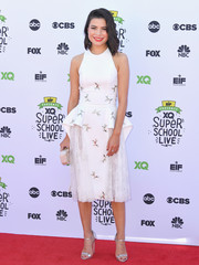 Miranda Cosgrove finished off her elegant look with silver ankle-strap sandals.