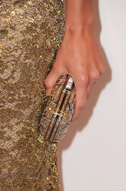 Hilary Swank showed off a glitzy Versailles box clutch, which perfectly complemented her Calvin Klein lace dress.