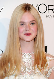 Elle Fanning looked as cute as a button in her pearly white dress. Center part locks were the perfect finish to her darling look.