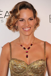 Hilary Swank gave her two-tone locks a retro twist with pinned up ringlets.