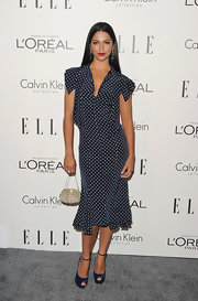 Camila Alves paired her feminine polka dot dress with blue peep-toe pumps.