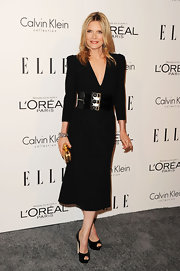 Michelle Pfeiffer accessorized her chic black dress with classic black peep-toe pumps.