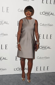 Viola Davis paired her chic and simple metallic shift dress with complementary metallic peep-toe pumps.