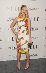 Alice Eve wore a pave diamond bangle in yellow gold, a pave diamond confetti bangle in sterling silver and pave diamond and cable stack bangles in 18-carat yellow gold at the 'Elle' 18th Annual Women in Hollywood tribute.