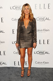 Jennifer Aniston shined at the Women in Hollywood Tribute wearing a bronze cocktail dress with a deep plunging v-neck.