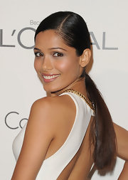 Freida Pinto's sleek ponytail looked perfectly elegant with her simple white gown and subtle makeup at the 'Elle' 18th Annual Women in Hollywood Tribute.