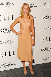 Naomi Watts topped off her look with nude platform pumps complete with criss-cross ankle straps.