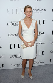 Brie Larson went for minimalist elegance in a white V-neck Calvin Klein dress during the Elle Women in Hollywood celebration.