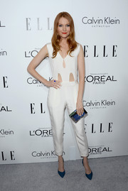 Darby Stanchfield looked modern in a sleeveless white jumpsuit with peekaboo detailing during the Elle Women in Hollywood celebration.