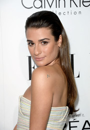 Lea Michele wore her long locks straight and slicked back when she attended the Elle Women in Hollywood celebration.