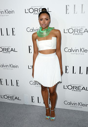 Kat Graham looked futuristic and sexy in a white crop-top and a pleated skirt at the Elle Women in Hollywood celebration.