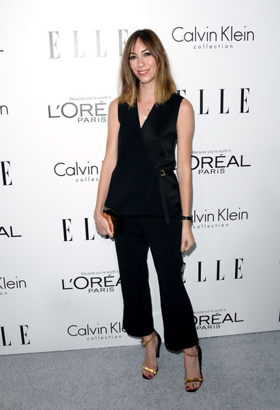 Gia Coppola went for a casual, smart look with a black Calvin Klein wrap top and a pair of ankle-length pants during the Elle Women in Hollywood celebration.