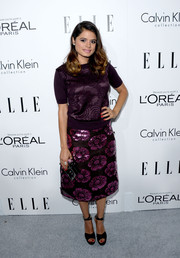 Melonie Diaz went matchy-matchy with this purple floral skirt and knit top combo at the Elle Women in Hollywood celebration.