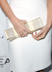 Brie Larson spruced up her plain white dress with an ultra-elegant nude snakeskin clutch at the Elle Women in Hollywood celebration.