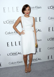 Ashley Madekwe looked effortlessly stylish in a white pinstripe dress by Thakoon during the Elle Women in Hollywood celebration.